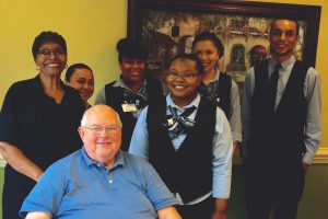 A birthday to remember! The South Village Dining Staff helps Jim Bundy celebrate in style.