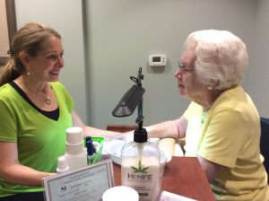 Phyllis Ussery, Manicurist pampers Eileen Herbermann, Springmoor resident, with a new nail color and a hand massage