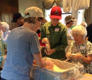 Stop Hunger Now volunteers Harriet Ross, Helen Schultz and Kris Lawyer