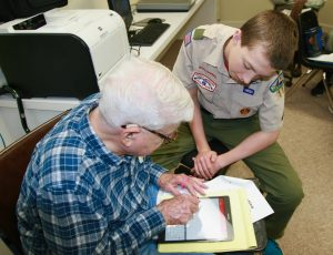 Scout, David Bass helping Bob Gardner learn a few new tricks on his iPad