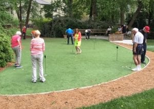 Putting on the Green provides a morning of friendly competition between neighbors