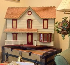 The dollhouse is tucked away in a corner for the grandchildren