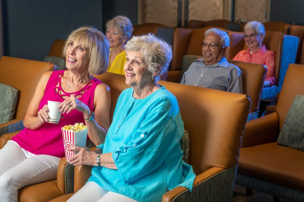 senior living in raleigh, seniors in a theater